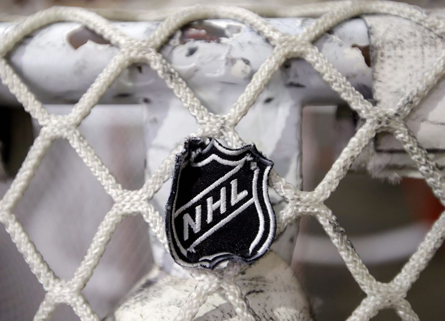 ** FILE ** In this file photo taken Sept. 17, 2012, the NHL logo is seen on a goal at a Nashville Predators practice rink in Nashville, Tenn. The NHL eliminated 16 more days from the regular-season schedule Monday, Dec. 10, 2012, and if a deal with the players' association isn't reached soon the whole season could be lost. (Associated Press)