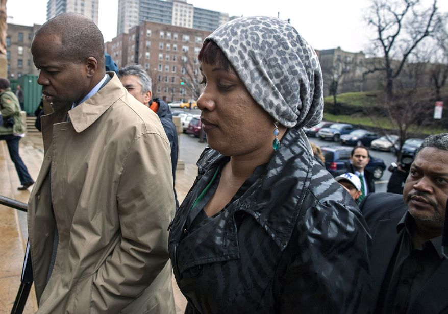 Nafissatou Diallo, who claimes she was sexually assaulted by former International Monetary Fund leader Dominique Strauss-Kahn, arrives at a courthouse in the Bronx borough of New York on Monday, Dec. 10, 2012. (AP Photo/Craig Ruttle)