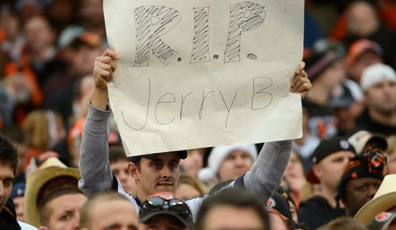 A fan holds a sign for Dallas Cowboys player Jerry Brown who was killed in an automobile accident during the Cowboys' 20-19 win over Cincinnati Bengals on Dec. 9, 2012, in Cincinnati. (Associated Press)