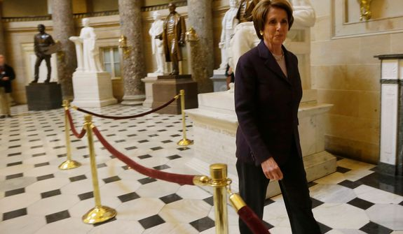 **FILE** House Minority Leader Nancy Pelosi, California Democrat, walks through Statuary Hall on Capitol Hill in Washington on Dec. 7, 2012, before her news conference. (Associated Press)