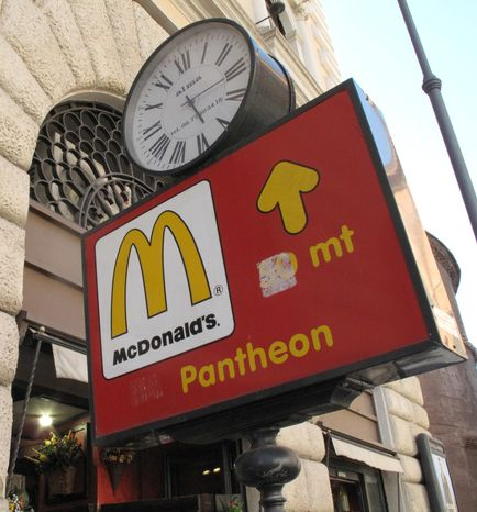 **FILE** A sign points to the McDonald's restaurant near the historic Pantheon in Rome on June 28, 2011. (Associated Press)