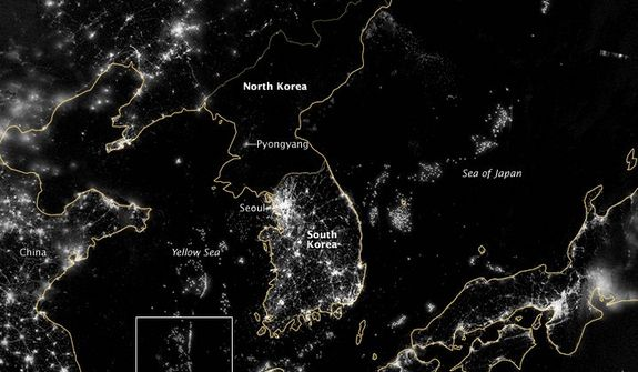 "**FILE** The Korean Peninsula is seen Sept. 24, 2012, at night from a composite assembled from data acquired by the Suomi NPP satellite. The image was made possible by the new satellite's ""day-night band"" of the Visible Infrared Imaging Radiometer Suite (VIIRS), which detects light in a range of wavelengths from green to near-infrared and uses filtering techniques to observe dim signals such as city lights, gas flares, auroras, wildfires, and reflected moonlight. City lights at night are a fairly reliable indicator of where people live. But this isn't always the case, and the Korean Peninsula shows why. (Associated Press/NASA)"