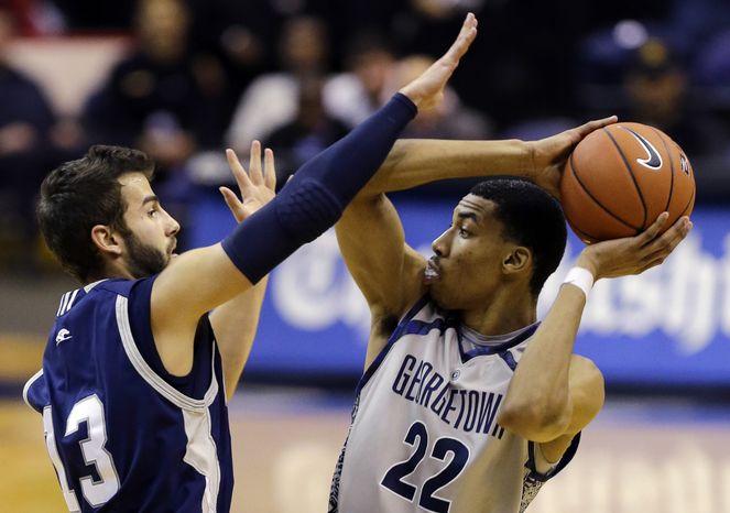 Longwood guard David Robinson (13) guards Georgetown forward Otto Porter Jr.,(22) during the second half of an NCAA college basketball game, Monday, Dec. 10, 2012, in Washington. Georgetown won 89-53. (AP Photo/Alex Brandon)
