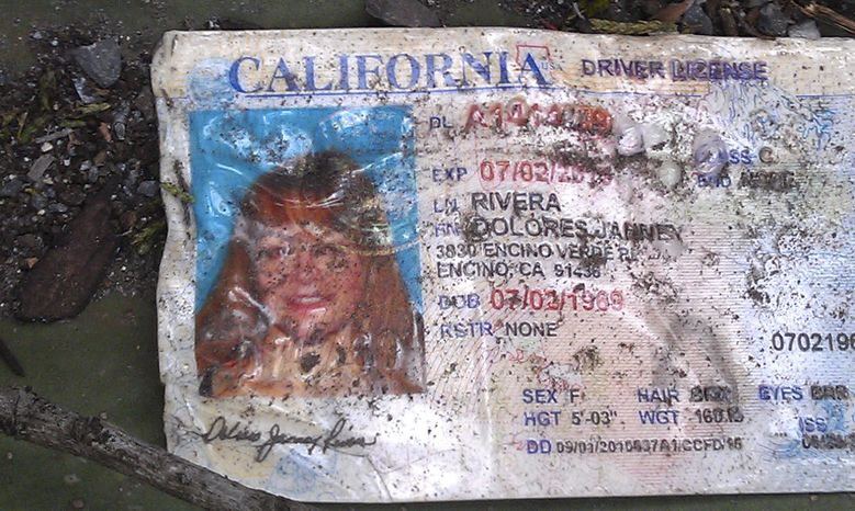 A California driver's license bearing the name of Jenni Rivera lies on the ground at the site where a plane allegedly carrying the singer crashed near Iturbide, Mexico, on Sunday Dec. 9, 2012. (AP Photo)