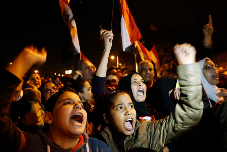 Protesters chant slogans during a demonstration in front of the presidential palace in Cairo on Dec. 9, 2012. (Associated Press)