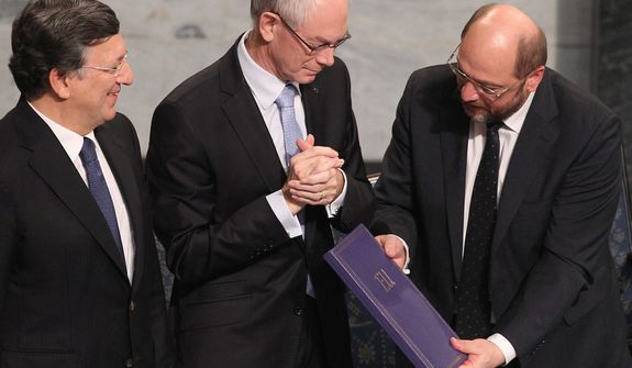 European Commission President Jose Manuel Barroso (left), European Council President Herman Van Rompuy (center) and European Parliament President Martin Schulz stand on the podium with the Nobel diploma at the City Hall in Oslo during the Nobel Peace Prize ceremony on Dec. 10, 2012. (Associated Press)