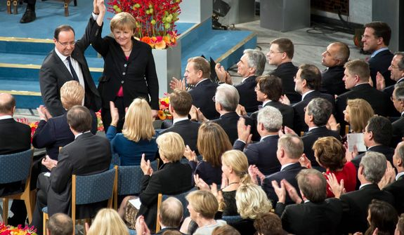 In this picture publicly provided by the German Government's Press Office, French President Francois Hollande and German chancellor Angela Merkel pose in Oslo during a ceremony at the City Hall in Oslo on Dec. 10, 2012. (Associated Press/Guido Bergmann/German Government)