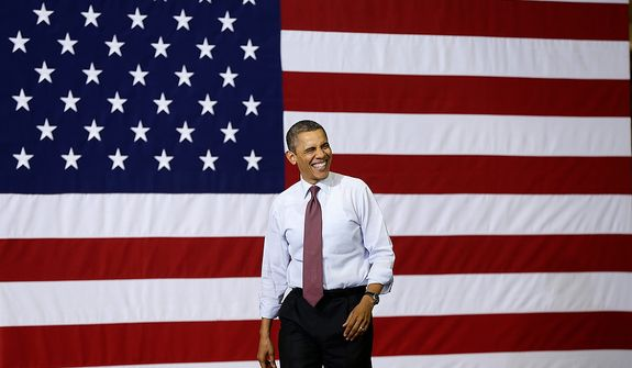 President Obama smiles as he arrives Dec. 10, 2012, to speak to workers during a visit to the Daimler Detroit Diesel plant in Redford, Mich. (Associated Press)