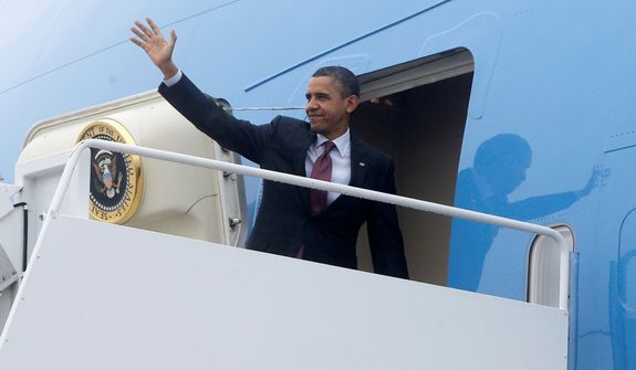 President Obama turns to wave as he boards Air Force One at Andrews Air Force Base in Washington's Maryland suburbs on Monday, Dec. 10, 2012, as he travels to the Daimler Detroit Diesel plant in Redford, Mich. (AP Photo/Charles Dharapak)