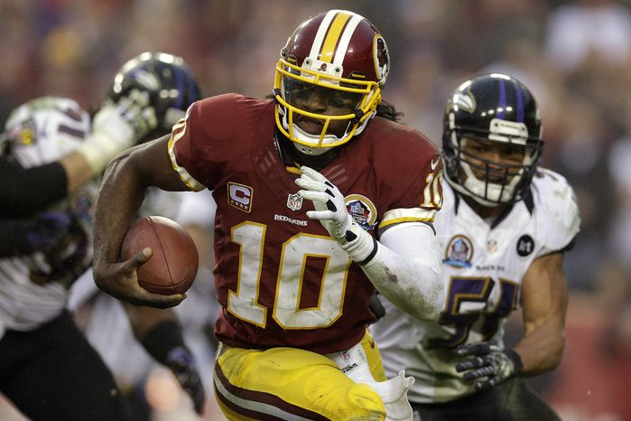 ** FILE ** Washington Redskins quarterback Robert Griffin III runs with the ball during the second half of an NFL football game against the Baltimore Ravens in Landover, Md., Sunday, Dec. 9, 2012. (AP Photo/Patrick Semansky)