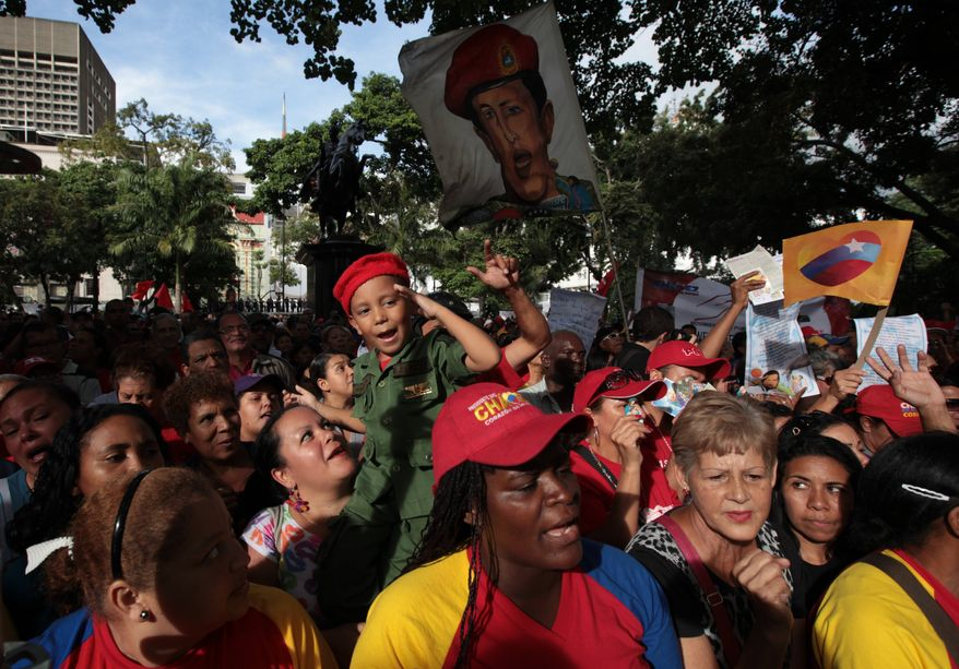 People attend a demonstration in support of Venezuela's President Hugo Chavez at the Simon Bolivar square in Caracas, Venezuela, on Dec. 9, 2012. (Associated Press)