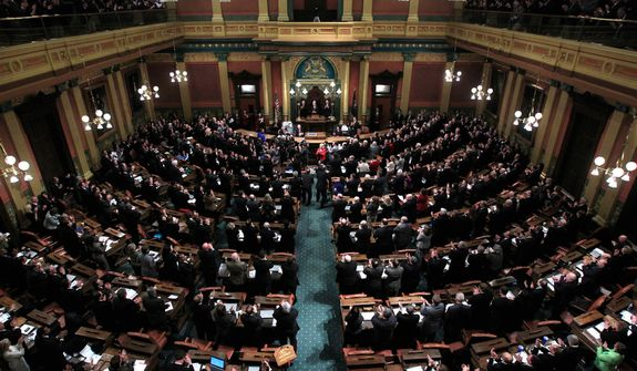Michigan Gov. Rick Snyder delivers his State of the State address to a joint session of the House and Senate in Lansing, Mich., Wednesday, Jan. 18, 2012. (AP Photo/Carlos Osorio)