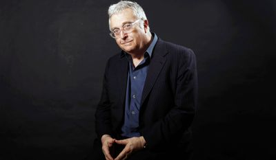 """FILE - This Feb. 7, 2011 file photo shows musician Randy Newman posing after the Academy Award Nominees Luncheon in Beverly Hills, Calif. The eclectic group of rockers Rush and Heart, rappers Public Enemy, songwriter Randy Newman, """"Queen of Disco"""" Donna Summer and bluesman Albert King will be inducted into the Rock and Roll Hall of Fame next April in Los Angeles. The inductees were announced Tuesday by 2012 inductee Flea of The Red Hot Chili Peppers at a news conference in Los Angeles. (AP Photo/Matt Sayles, file)"""