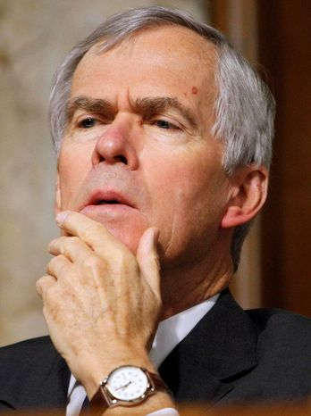 Sen. Jeff Bingaman reported the Dec. 3 sale of between $250,001 and $500,000 in HSBC stock on forms he filed with the Senate on Dec. 8. Three days later, HSBC announced it agreed to the record settlement. (Associated Press)