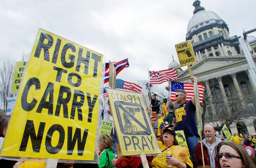 Gun owners and supporters participate in an Illinois Gun Owners Lobby Day rally at the Capitol in Springfield in March 2012. (Associated Press)