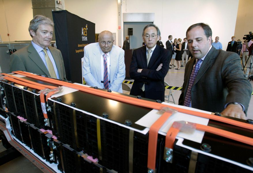 **FILE** U.S. Energy Secretary Steven Chu (second from right) listens as Jason Forcier (right), vice president and general manager of A123 Systems, shows off a battery at their plant in Romulus, Mich., on July 18, 2011. Standing at left is A123 President and CEO David Vieau and Rep. John Dingell, Michigan Democrat. (Associated Press)
