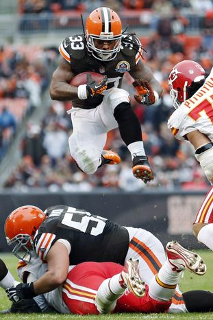 Cleveland Browns running back Trent Richardson (33) leaps over the line during the third quarter of an NFL football game against the Kansas City Chiefs, Sunday, Dec. 9, 2012, in Cleveland. (AP Photo/Rick Osentoski)