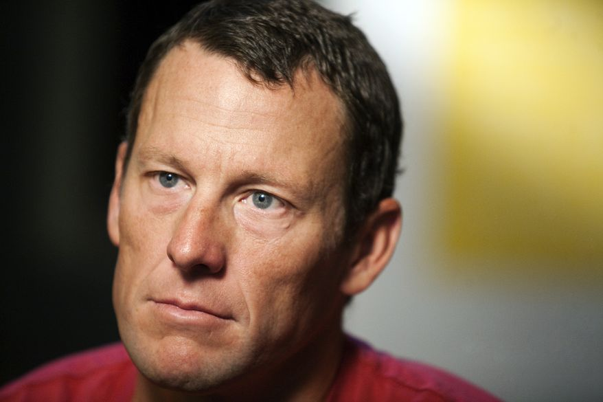 **FILE** Lance Armstrong pauses during an interview in Austin, Texas, on Feb. 15, 2011. (Associated Press)