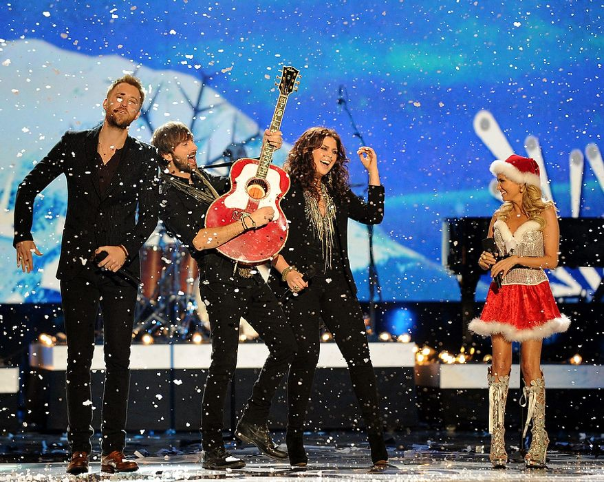 Lady Antebellum performs with Kristin Chenoweth during the American Country Awards on Monday, Dec. 10, 2012, in Las Vegas. (Al Powers/Powers Imagery/Invision/AP)