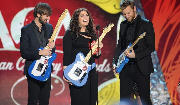 Lady Antebellum accepting award for Group of the Year during the American Country Awards on Monday, Dec. 10, 2012, in Las Vegas. (Al Powers/Powers Imagery/Invision/AP)
