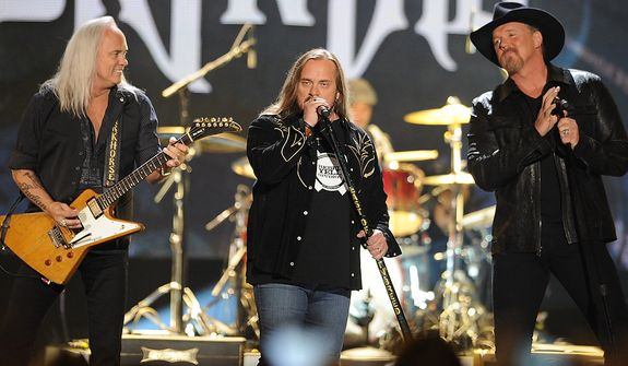 Lynyrd Skynyrd and Trace Adkins perform during the American Country Awards on Monday, Dec. 10, 2012, in Las Vegas. (Al Powers/Powers Imagery/Invision/AP)