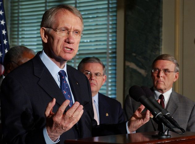 Senate Minority Leader Harry Reid, D-Nev., discusses the Senate's upcoming votes on judicial nominations during a news conference on Capitol Hill Tuesday, May 24, 2005. In the back ground are Rep. Robert Menendez, D-N.J., center, and Sen. Byron Dorgan, D-N.D. (AP Photo/Dennis Cook)