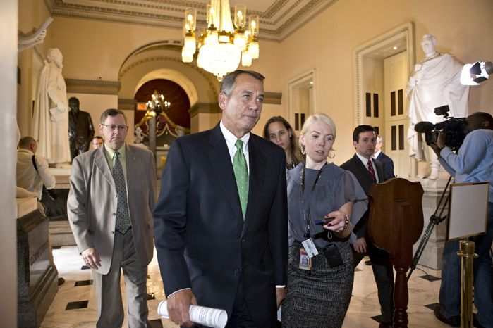 House Speaker John Boehner of Ohio is pursued by reporters as he walks to the House floor to deliver remarks about negotiations with President Barack Obama on the fiscal cliff, Tuesday, Dec. 11, 2012, on Capitol Hill in Washington. Boehner said President Barack Obama is slow-walking talks to avoid the fiscal cliff, and hasn't outlined spending cuts he's willing to support as part of a compromise. (AP Photo/J. Scott Applewhite)