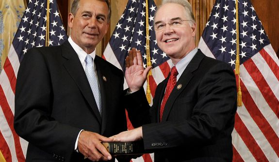 House Speaker John A. Boehner (left), Ohio Republican, participates in a ceremonial House swearing-in ceremony for Rep. Tom Price, Georgia Republican, on Capitol Hill in Washington on Wednesday, Jan. 5, 2011. (AP Photo/Alex Brandon)