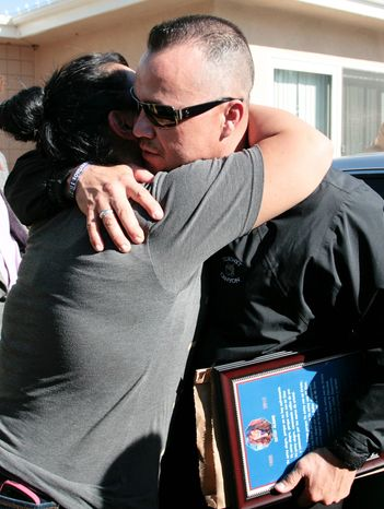 Pedro Rivera Jr. (right), brother of singer Jenni Rivera, is greeted by a well-wisher as he arrives at his mother's home in Lakewood, Calif., on Dec. 10, 2012. Jenni Rivera died Dec. 9 in a plane crash in Mexico. (Associated Press)