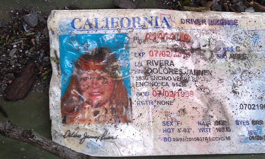 A California driver's license bearing the name of Jenni Rivera sits on the ground at the site where a plane carrying Rivera crashed near Iturbide, Mexico, on Dec. 9, 2012. (Associated Press)