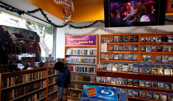 Singer Jenni Rivera is seen on a video screen at a music store in Mexico City on Dec. 10, 2012. U.S. authorities confirmed that Rivera, a U.S.-born singer whose soulful voice and openness about her personal troubles made her a Mexican-American superstar, was killed in a Dec. 9 plane crash in northern Mexico. (Associated Press)