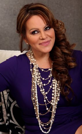 **FILE** Mexican-American singer and reality TV star Jenni Rivera poses during an interview in Los Angeles on March 8, 2012. (Associated Press)