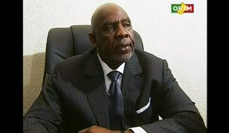 In this still frame made from video provided by ORTM Mali TV, Mali's Prime Minister Cheikh Modibo Diarra resigns during a broadcast on state television from Bamako, Mali, on Dec. 11, 2012, hours after soldiers who led a recent coup burst into his home and arrested him. (Associated Press)