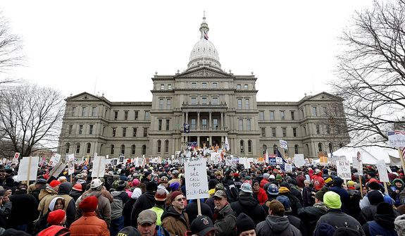 Protesters gather for a rally at the state Capitol in Lansing, Mich., on Tuesday, Dec. 11, 2012, to demonstrate against legislation that could make Michigan the 24th state with a right-to-work law. (AP Photo/Paul Sancya)