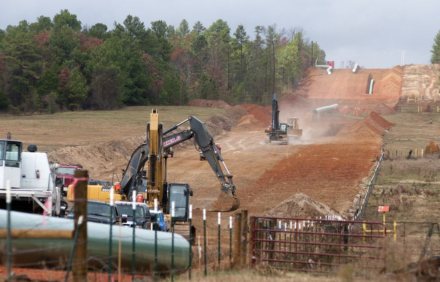 **FILE** Crews work on construction of the TransCanada Keystone XL Pipeline near County Road 363 and County Road 357, east of Winona, Texas, on Dec. 3, 2012. (Associated Press/The Tyler Morning Telegraph)