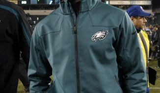 Injured Philadelphia Eagles quarterback Michael Vick walks on the field after an NFL football game against the Carolina Panthers Monday, Nov. 26, 2012, in Philadelphia. (AP Photo/Mel Evans)