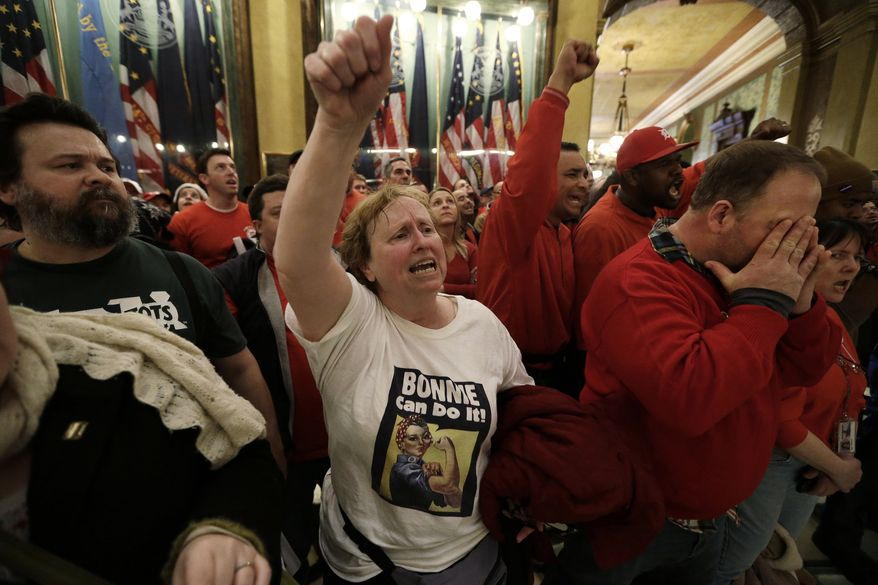Demonstrators gather for a rally in the rotunda at the State Capitol in Lansing, Mich., on Dec. 11, 2012, to protest right-to-work legislation passed the previous week. (Associated Press)