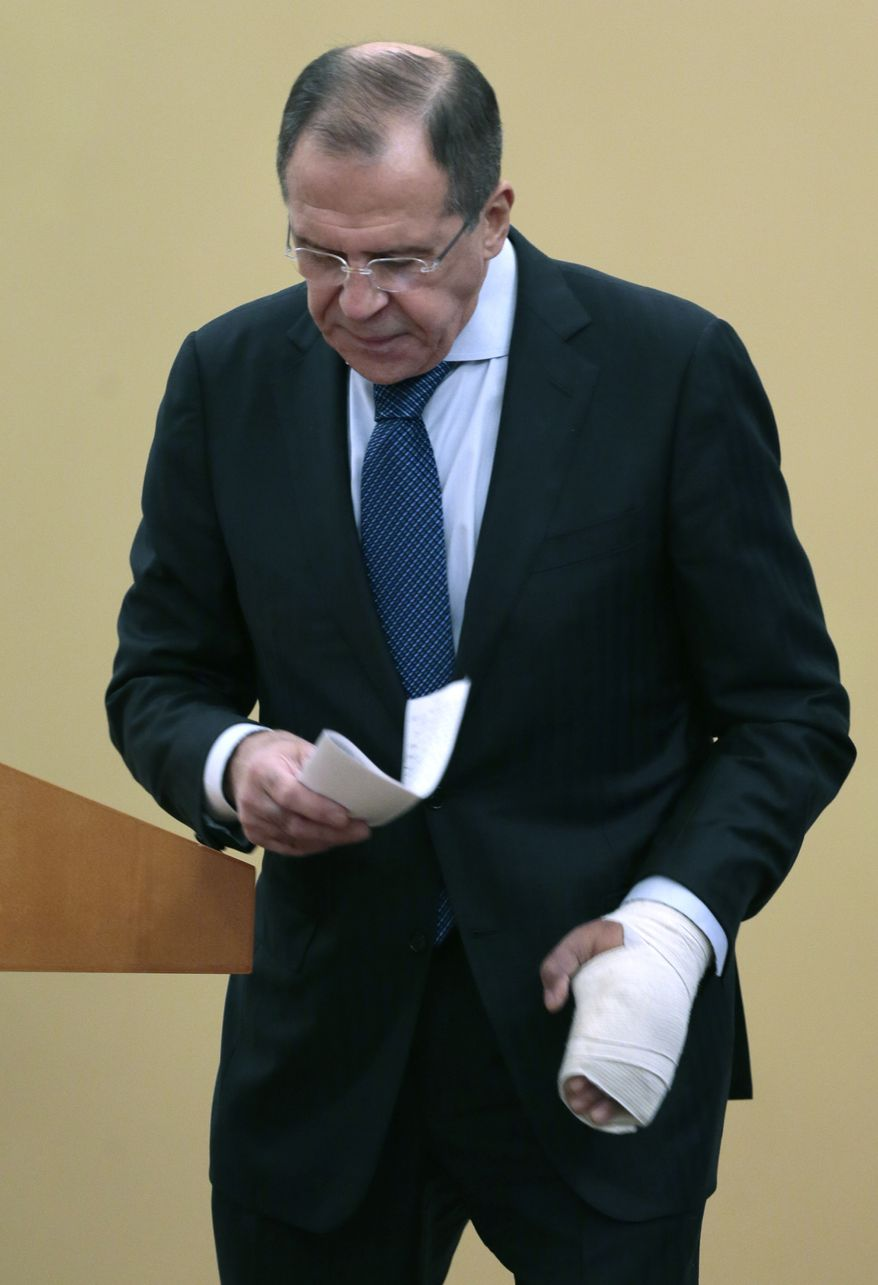 Russian Foreign Minister Sergey Lavrov walks Dec. 10, 2012, after speaking at the International Parliamentary Forum in Moscow, Russia. (Associated Press)
