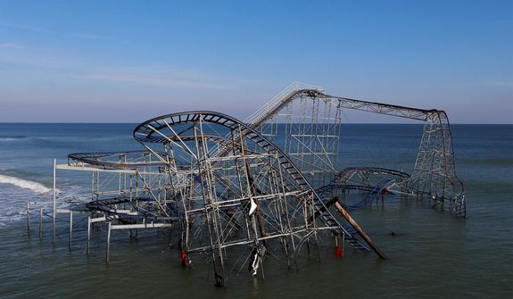 A roller coaster that once stood on the Funtown Pier at Seaside Heights, N.J., is seen dunked in the ocean on Thursday, Nov. 29, 2012, after the pier was hit by superstorm Sandy. (AP Photo/Julio Cortez)