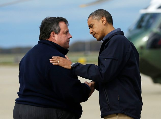 President Obama (right) is greeted by New Jersey Gov. Chris Christie upon the president's arrival at the Atlantic City International Airport outside Atlantic City, N.J., on Wednesday, Oct. 31, 2012. Mr. Obama traveled to the region to take an aerial tour of the Atlantic coast of New Jersey in areas damaged by Superstorm Sandy. (AP Photo/Pablo Martinez Monsivais)