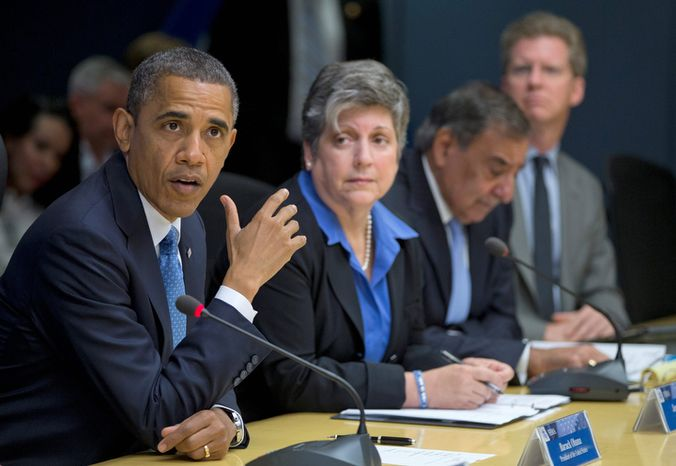 President Obama, accompanied by members of his Cabinet, speaks about superstorm Sandy at the Federal Emergency Management Agency headquarters in Washington on Wednesday, Oct. 31, 2012. With him are (from second from the left) Homeland Security Secretary Janet Napolitano, Defense Secretary Leon E. Panetta and Housing and Urban Development Secretary Shaun Donovan. (AP Photo/Carolyn Kaster)