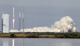 ** FILE ** A United Launch Alliance Atlas V rocket carrying an X-37B experimental robotic space plane lifts off from Launch Complex 41 at the Cape Canaveral Air Force Station on Tuesday, Dec. 11, 2012, in Cape Canaveral, Fla. Air Force officials said the unmanned space plane, which resembles a miniature space shuttle, provides a way to test technologies in space. (AP Photo/John Raoux)