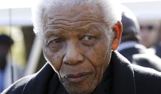 Former South African President Nelson Mandela leaves the chapel after attending the funeral of his great-granddaughter Zenani Mandela in Johannesburg in 2010. (AP Photo/Siphiwe Sibeko, Pool)