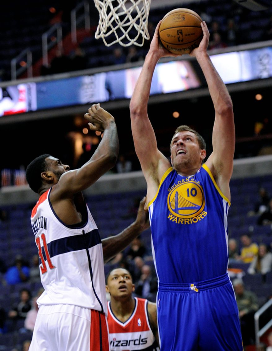 Golden State Warriors forward David Lee (10) goes to the basket against Washington Wizards forward Chris Singleton (31) during the first half of the Warriors' 101-97 win on Dec. 8, 2012, in Washington. (Associated Press)