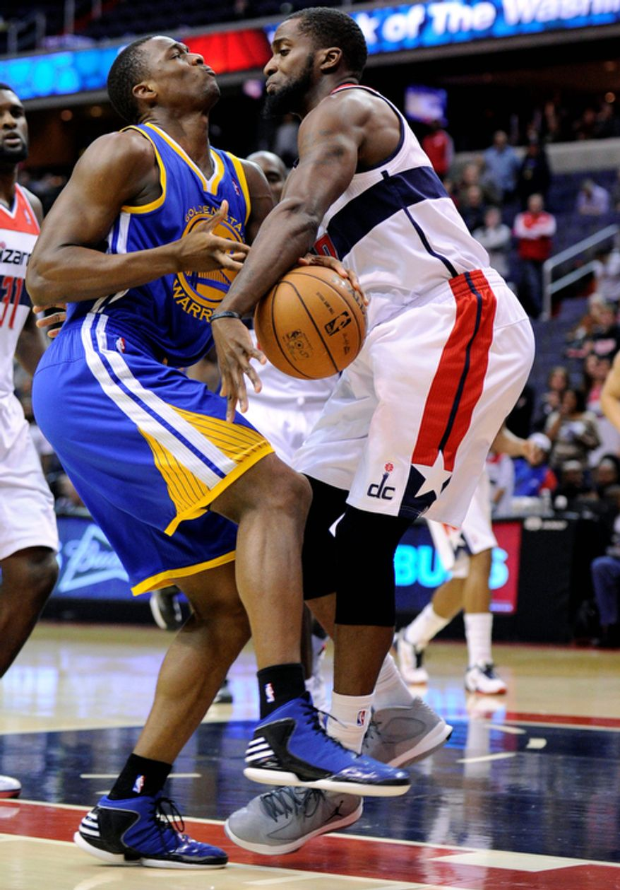 Golden State Warriors forward Harrison Barnes (left) collides with Washington Wizards forward Martell Webster during the first half of the Warriors' 101-97 win on Dec. 8, 2012, in Washington. (Associated Press)
