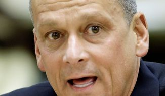 """Tony Bennett, the Indiana schools chief ousted from office five weeks ago, was named Florida's education commissioner Wednesday. Mr. Bennett was hailed by Florida Gov. Rick Scott for his """"great track record of achievement in Indiana."""" (Associated Press)"""