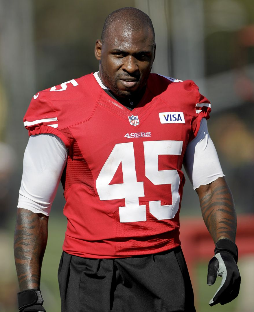 "The 49ers suspended running back Brandon Jacobs on Monday for the final three games following a series of posts on social media sites addressing his lack of playing time, including one during the weekend saying he was ""on this team rotting away."" (AP Photo/Paul Sakuma, File)"