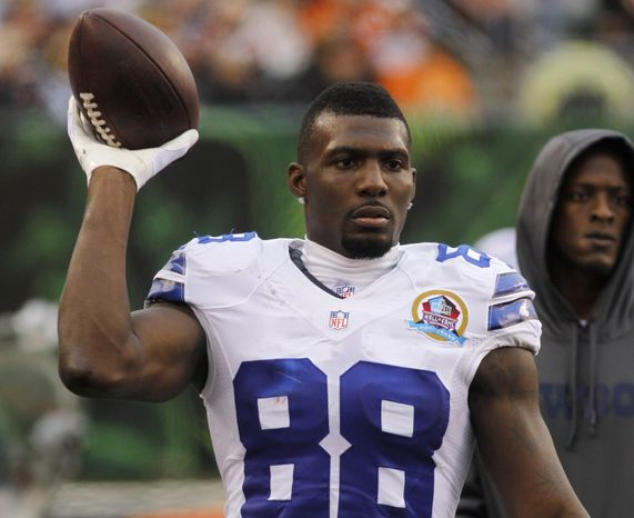 Dallas Cowboys wide receiver Dez Bryant tosses a football on the sidelines in the second half of an NFL football game against the Cincinnati Bengals, Sunday, Dec. 9, 2012, in Cincinnati. (AP Photo/Tom Uhlman)