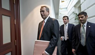 """House Speaker John Boehner, Ohio Republican, arrives Dec. 12, 2012, for a closed-door meeting with the GOP caucus on Capitol Hill in Washington. Boehner and the other House Republican leaders are calling for President Obama to come up with plan they can accept for spending cuts and tax revenue to avoid the so-called """"fiscal cliff"""" of automatic tax hikes and budget reductions. (Associated Press)"""