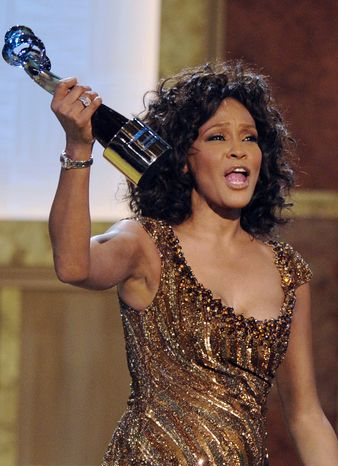 **FILE** Whitney Houston accepts an award at the Warner Theatre during the 2010 BET Hip Hop Honors in Washington on Jan. 16, 2010. (Associated Press)